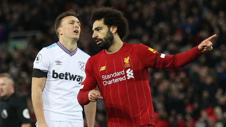 Mohamd Salah celebrates hauling Liverpool level against West Ham at Anfield