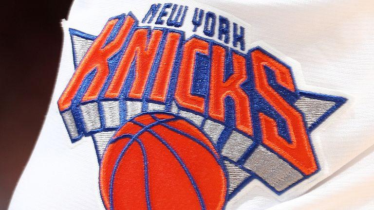 A close up of the New York Knicks logo