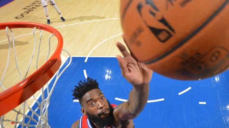 Norvel Pelle of the Philadelphia 76ers blocks a shot