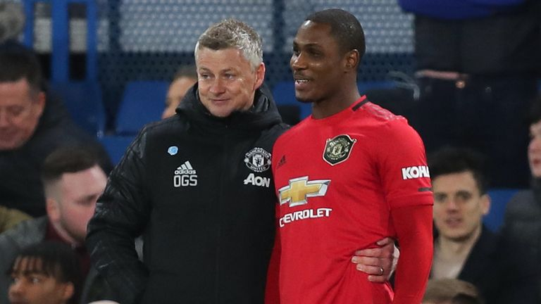 Odion Ighalo with Ole Gunnar Solskjaer before coming on as substitute at Stamford Bridge