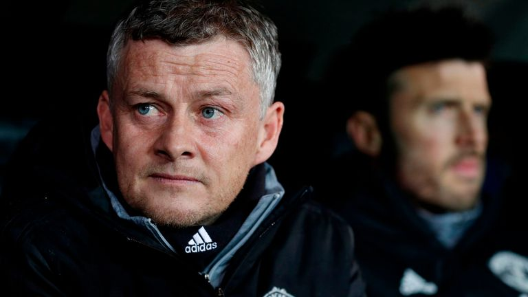 Ole Gunnar Solskjaer (L) looks on flanked by Manchester United's English first-team coach Michael Carrick