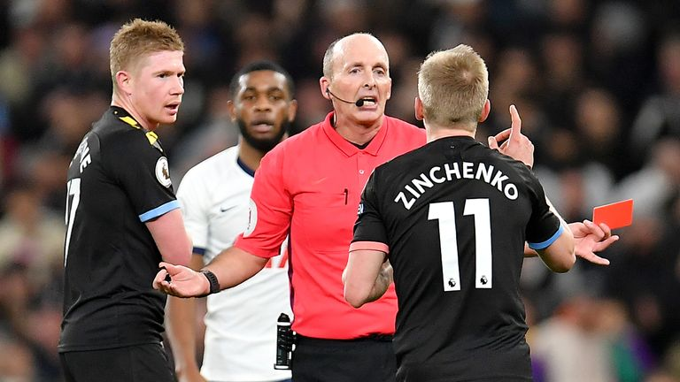 Oleksandr Zinchenko of Manchester City reacts after being sent off by Mike Dean