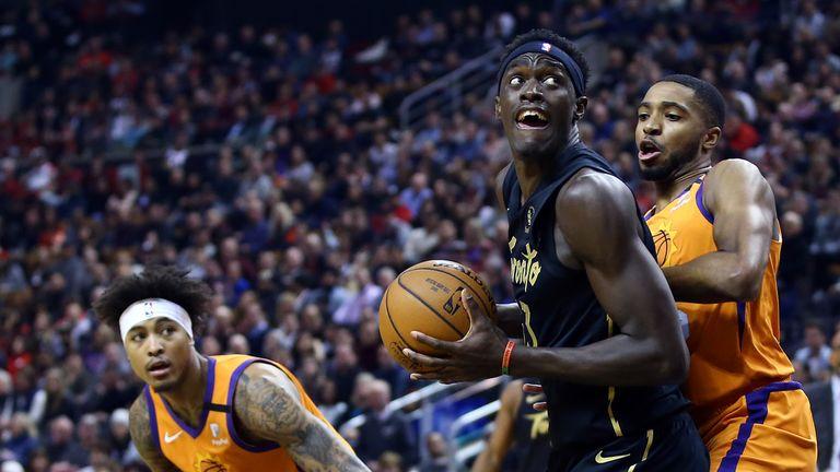 Pascal Siakam of the Toronto Raptors shoots the ball as Mikal Bridges of the Phoenix Suns