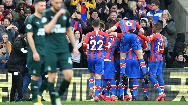 Patrick van Aanholt is mobbed by team-mates after opening the scoring against Newcastle