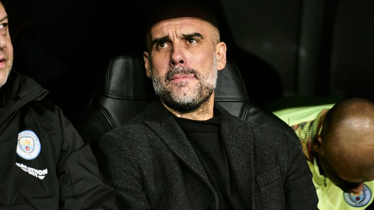 Pep Guardiola watches on from the dugout at the Bernabeu