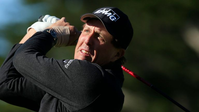 Mickelson trailed by five at the turn after big mistakes at eight and nine