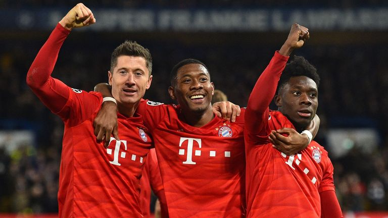 Robert Lewandowski (L) celebrates with David Alaba and Alphonso Davies after scoring against Chelsea