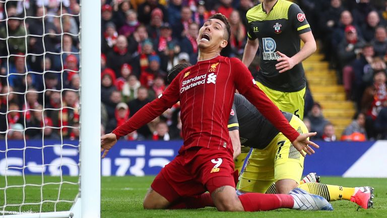 Roberto Firmino goes down the penalty area