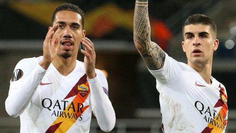 Chris Smalling and Gianluca Mancini celebrate after Roma progress