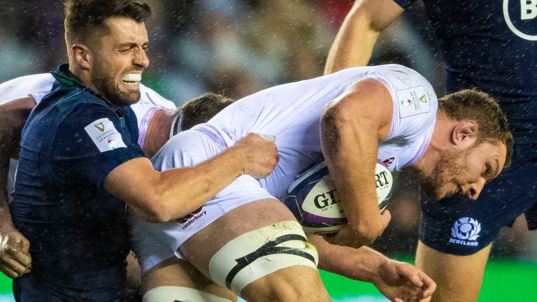 England's Sam Underhill is tackled by Scotland's Adam Hastings