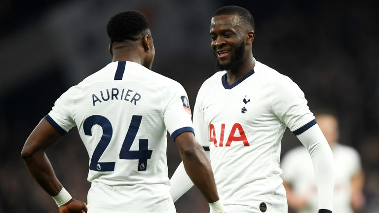 Serge Aurier and Tanguy Ndombele celebrate after Jack Stephens' own goal