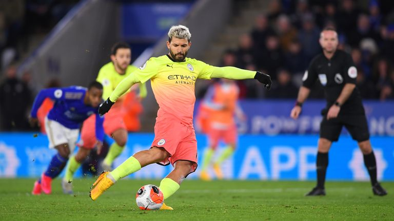 Sergio Aguero takes his penalty, but it's saved by Kasper Schmeichel