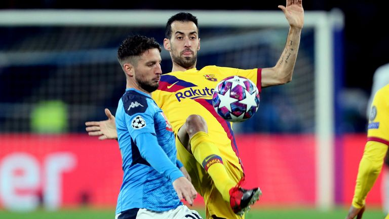 Sergio Busquets launches into Mertens to end his night with a late challenge