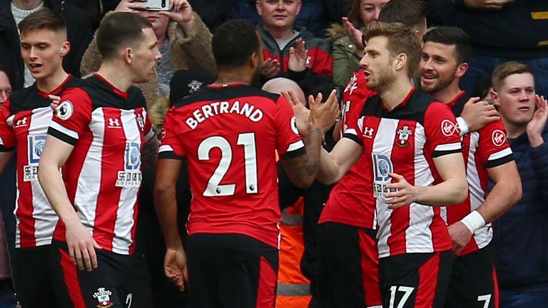 Shane Long celebrates his goal against Villa with his team-mates