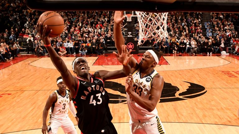 Pascal Siakam of the Toronto Raptors drives to the basket during a game against the Indiana Pacers