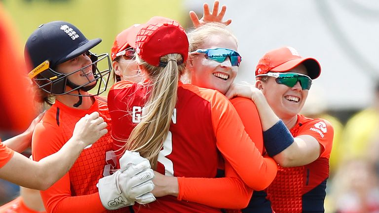 Spinner Sophie Ecclestone (second right) celebrates after dismissing Australia's Ellyse Perry during the Tri-Series