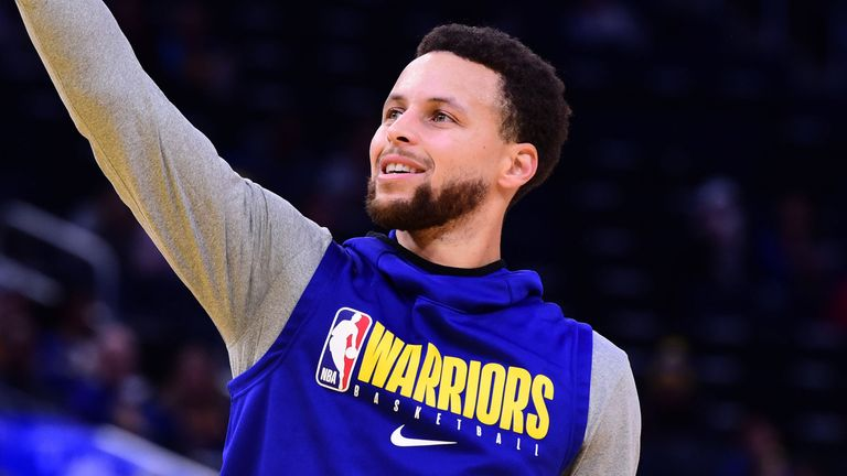 Stephen Curry shoots during warm-ups at a Warriors game