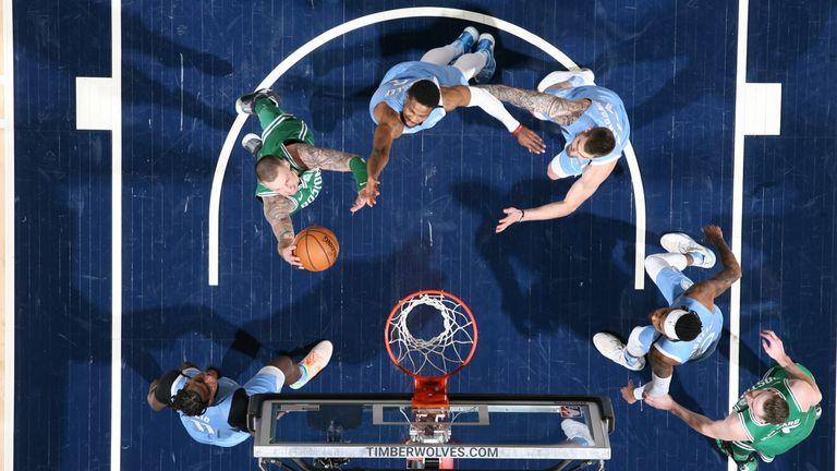Daniel Theis of the Boston Celtics shoots the ball against the Minnesota Timberwolves