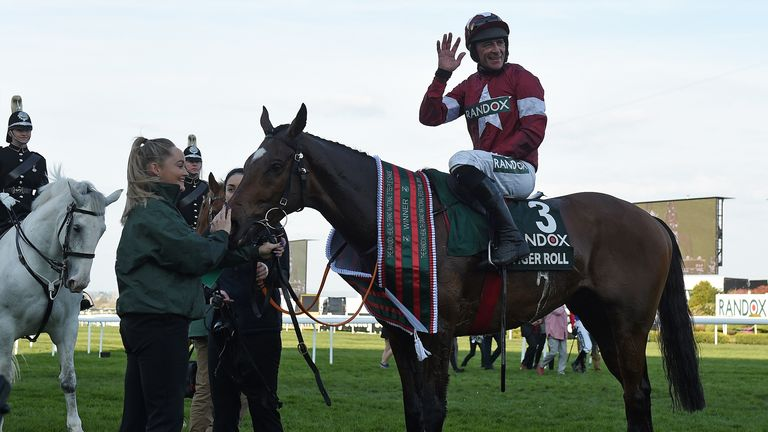 Davy Russell celebrates after riding Tiger Roll to victory in the 2019 Grand National