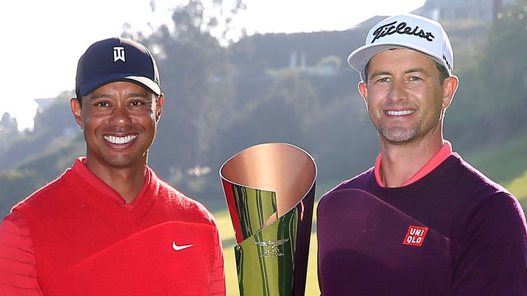 Woods presented the trophy to Adam Scott after his two-shot victory
