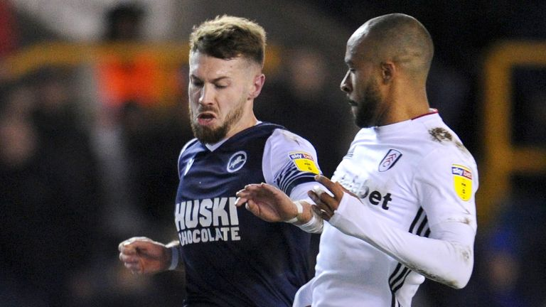 Tom Bradshaw of Millwall is challenged by Denis Odoi of Fulham