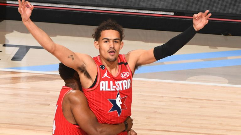 Trae Young celebrates after draining a halfcourt buzzer-beater in the All-Star Game