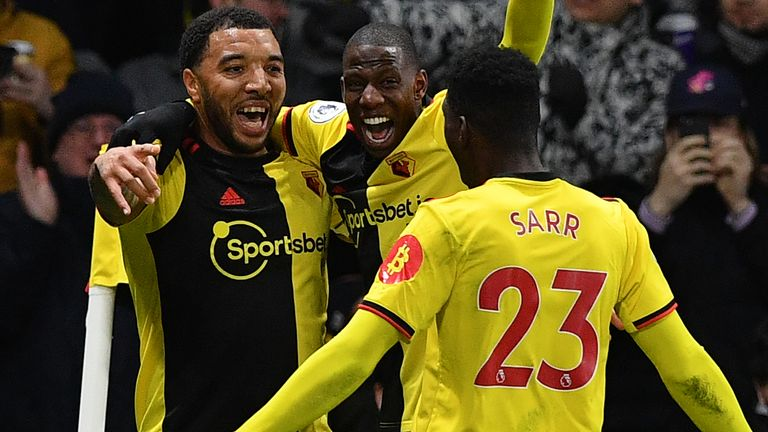 Troy Deeney celebrates his goal with Abdoulaye Doucoure and Ismaila Sarr