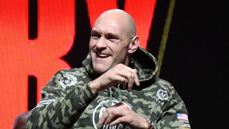 Tyson Fury waves to his fans as he weighs in at 173 pounds at todays weigh-in at MGM Grand Hotel Friday February 21, 2020. Tyson Fury will be fighting Deontay Wilder for the second time Saturday for the world heavyweight championship Saturday in Las Vegas, Nevada