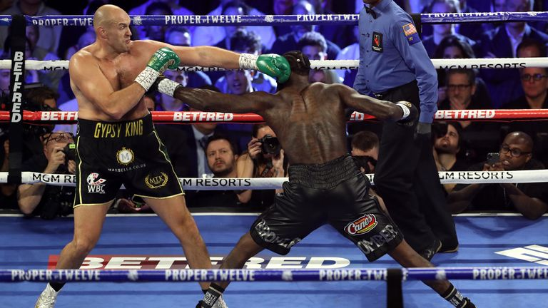 Tyson Fury (left) and Deontay Wilder during the World Boxing Council World Heavy Title bout at the MGM Grand, Las Vegas. PA Photo. Picture date: Saturday February 22, 2020. See PA story BOXING Las Vegas. Photo credit should read: Bradley Collyer/PA Wire.
