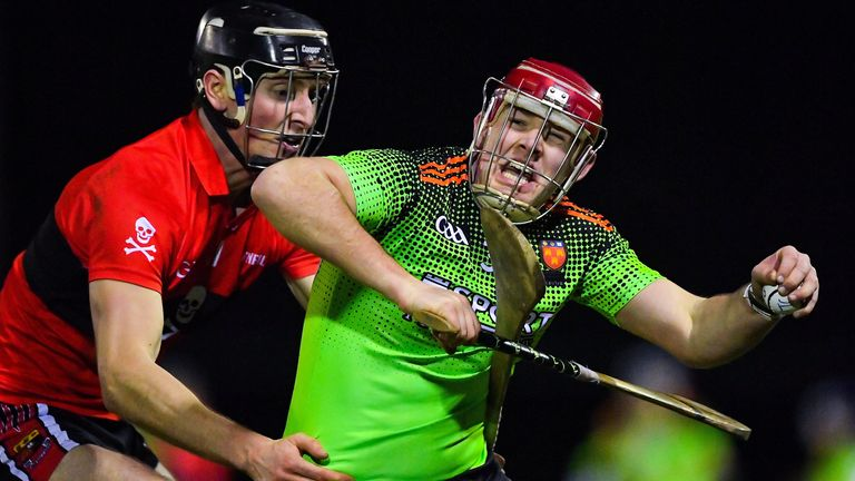 Jerry Kelly of IT Carlow in action against Conor Boylan of UCC