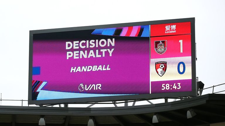 An LED screen shows the VAR decision which awards Burnley a penalty after a handball during the Premier League match between Burnley FC and AFC Bournemouth at Turf Moor on February 22, 2020 in Burnley, United Kingdom