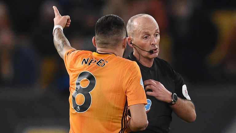 Ruben Neves remonstrates with Mike Dean after Wolves are denied the opener