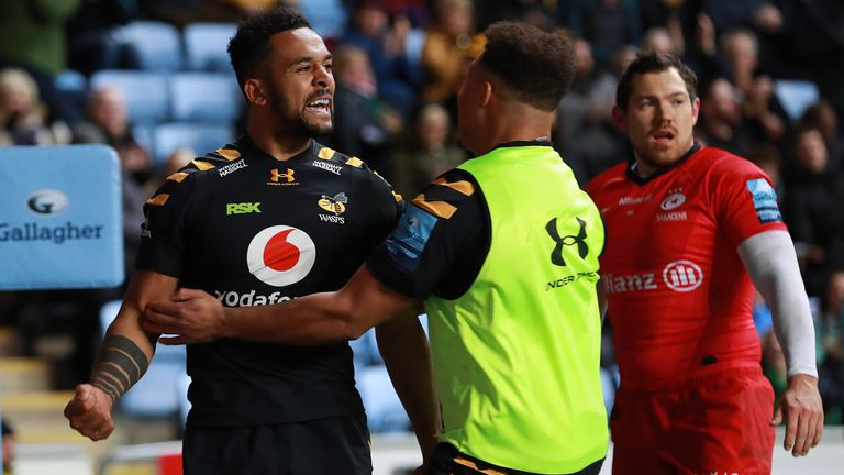 Zach Kibirige of Wasps celebrates his try during the Gallagher Premiership Rugby match between Wasps and Saracens at on February 21, 2020 in Coventry, England