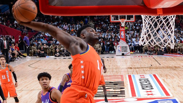 Zion Williamson cocks his right arm before throwing down a huge dunk in the RIsing Stars Game