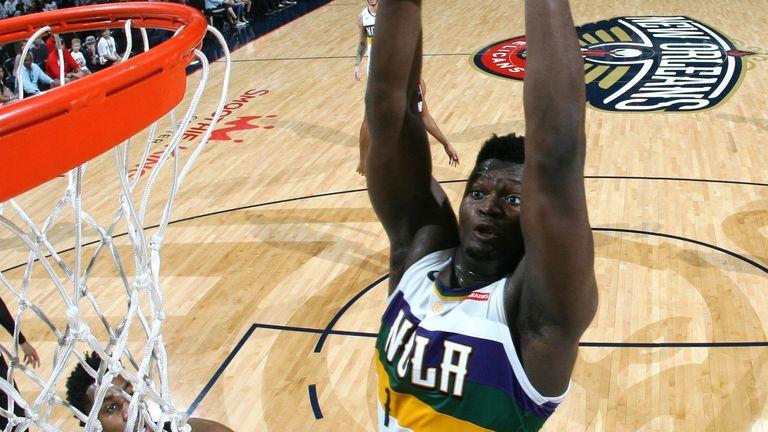 Zion WIlliamson throws down a dunk against the Portland Trail Blazers