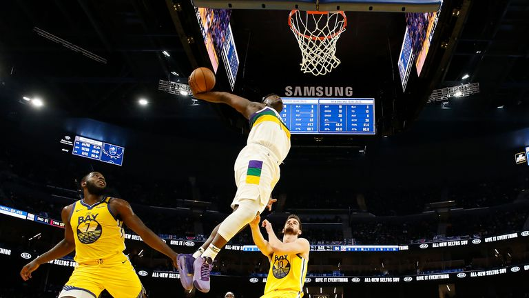 Zion Williamson of the New Orleans Pelicans drives to the basket against the Golden State Warriors