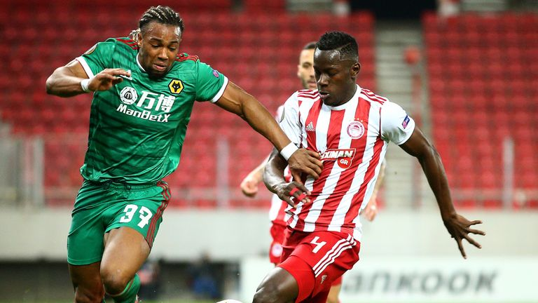 Adama Traore and Mady Camara battle for possession during Wolves' Europa League tie against Olympiakos