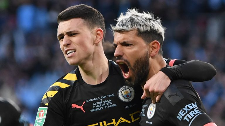 Sergio Aguero and Phil Foden celebrate the opening goal in the Carabao Cup final