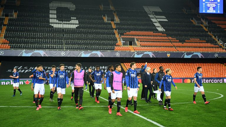 Atalanta celebrate their win in an empty stadium