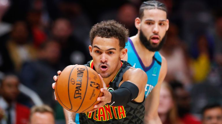 Trae Young fakes a pass during the Atlanta Hawks' double-overtime clash with the Charlotte Hornets