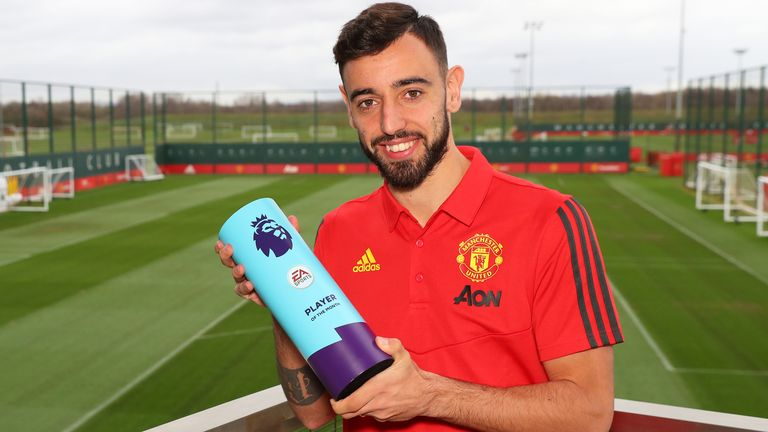Bruno Fernandes is presented with the award for 'Premier League Player of the Month for February' at Carrington