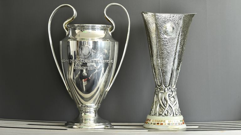 Image of both the UEFA Champions League and Europa League trophies