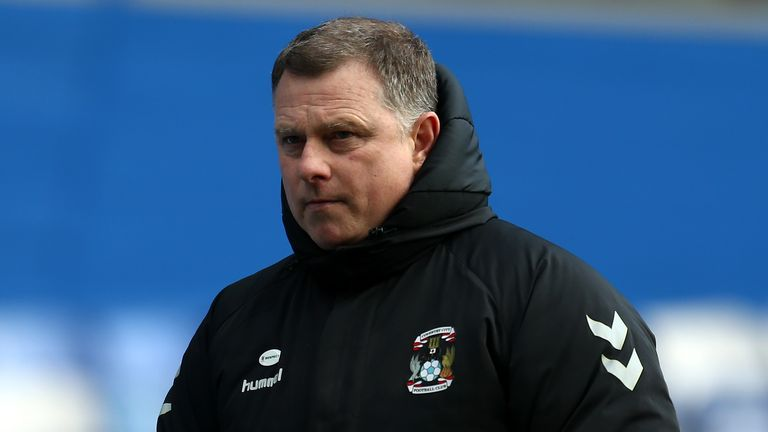 Mark Robins celebrated victory in his 200th game in charge