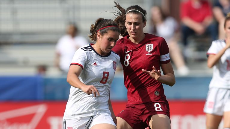 Maria Caldentey of Spain and Jill Scott of England fight for the ball