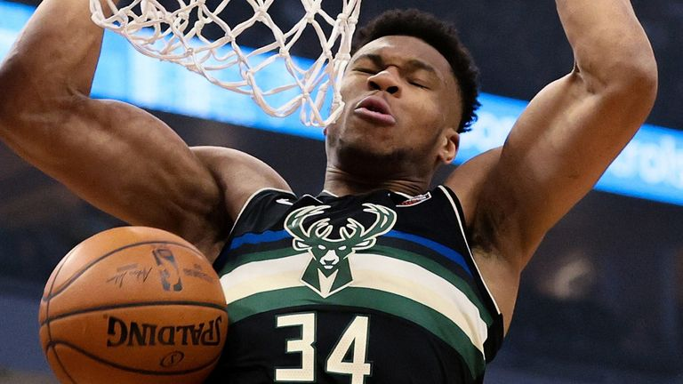 Giannis Antetokounmpo scores with a two-handed dunk en route to 41 points against the Charlotte Hornets
