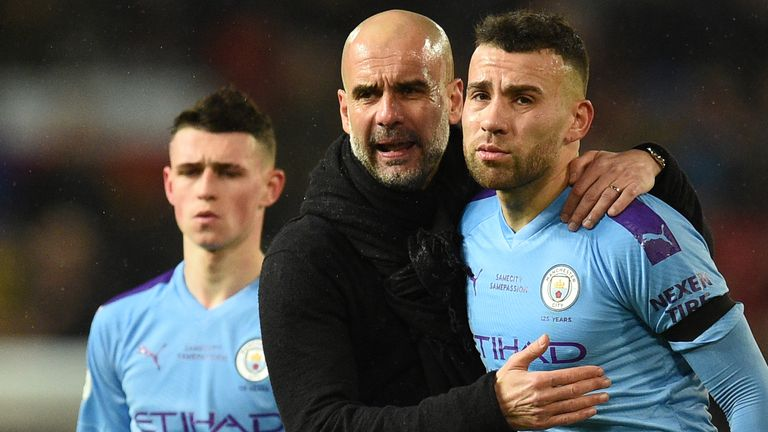 Pep Guardiola and Nicolas Otamendi after Manchester City's defeat at Manchester United