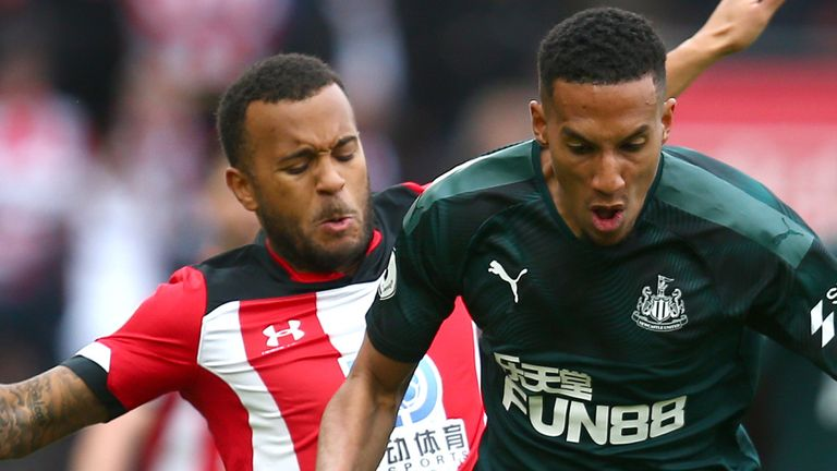 Isaac Hayden of Newcastle United battles for possession with Ryan Bertrand of Southampton