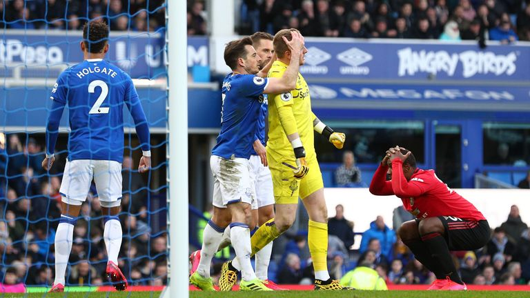 Jordan Pickford's Everton team-mates congratulate him on his late save against Manchester United