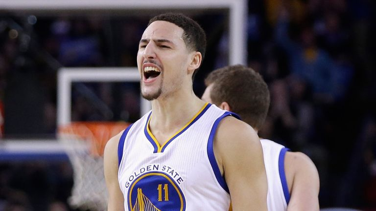 Klay Thompson celebrates after scoring 37 points in a single quarter against the Sacramento Kings in January 2015