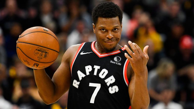 Kyle Lowry signals to a Raptors team-mate